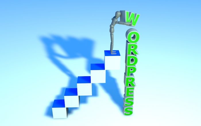Web Design Guelph - Image for blog post. Figure standing on stairs, stacking block letters that spell wordpress