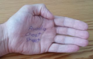 Picture of a person's hand Avada Cheat Sheet written in ink on the palm